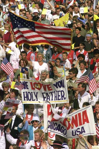 A large group of American Catholics from Chicago, Ill. cheers as they welcome Pope John Paul II upon his arrival at the God&#39;s Mercy Basilica in Krakow, southern Poland, Saturday, Aug.17, 2002. Tens of thousands of adoring Poles gave the ailing Pope John Paul II a joyous welcome home Saturday, lining a seven-mile route and shouting &#34;Long live the pope!&#39;&#39; as he arrived to consecrate a new basilica.  <span class=meta>(&#40;AP Photo&#47;Jockel Finck&#41;)</span>